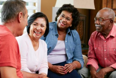 aurora based dental implant patients engaging in conversation